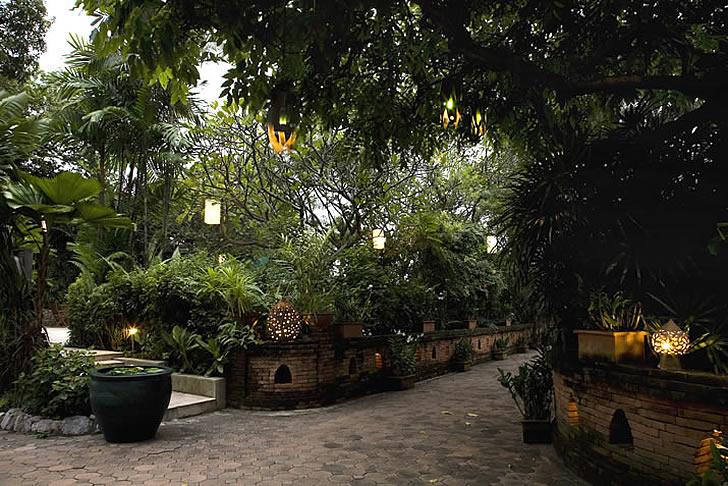 Chakrabongse Villas, Bangkok, Thailand - gardens with lanterns lit