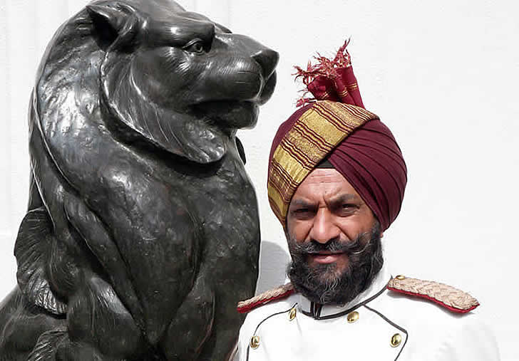 India, Delhi, Imperial Hotel doorman, photographer Steven Hummel